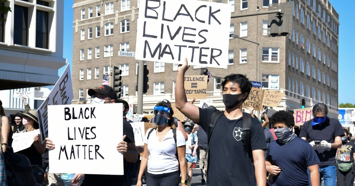 Protesters march at the Glendale Community March and Vigil for Black Lives Matter on June 7, 2020 in Glendale, California.