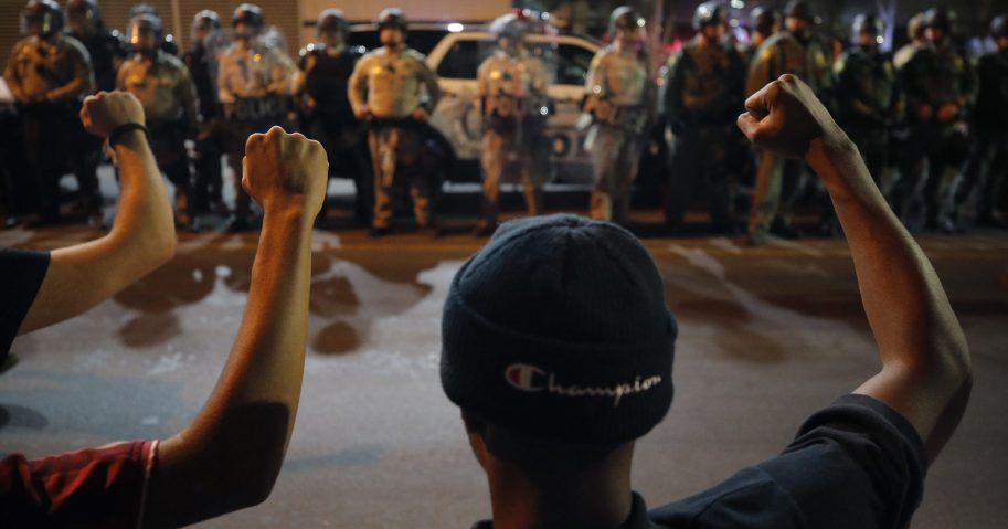 Protesters raise their fists during a rally on Monday, June 1, 2020, in Las Vegas, over the death of George Floyd, a black man who died in police custody in Minneapolis.