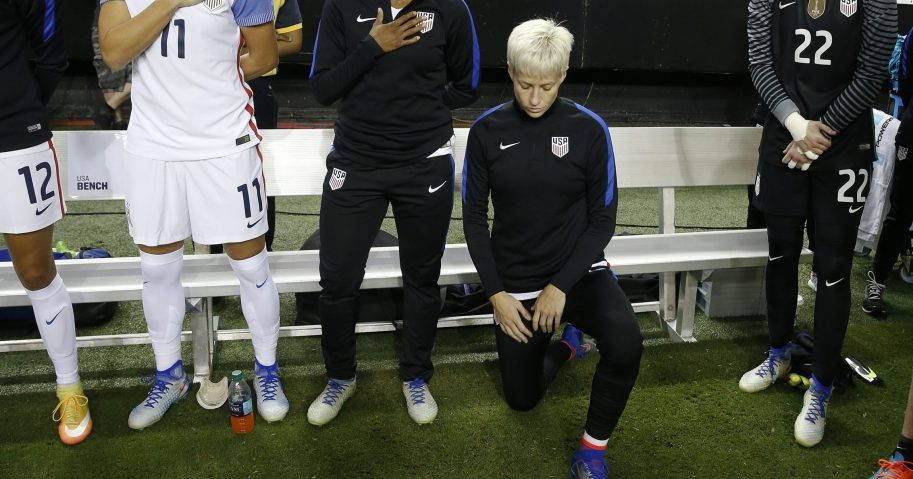 Megan Rapinoe kneels next to her U.S. teammates as the national anthem is played before the team's exhibition soccer match against the Netherlands in Atlanta on Sept. 18, 2016.