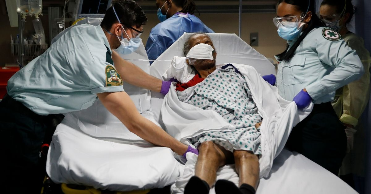 In this April 20, 2020, file photo, emergency medical technicians transport a patient from a nursing home to an emergency room bed at St. Joseph's Hospital in Yonkers, New York. Nursing home residents account for nearly 1 in 10 of all COVID-19 cases in the United States and more than a quarter of the deaths, according to an Associated Press analysis of government data released on June 18.