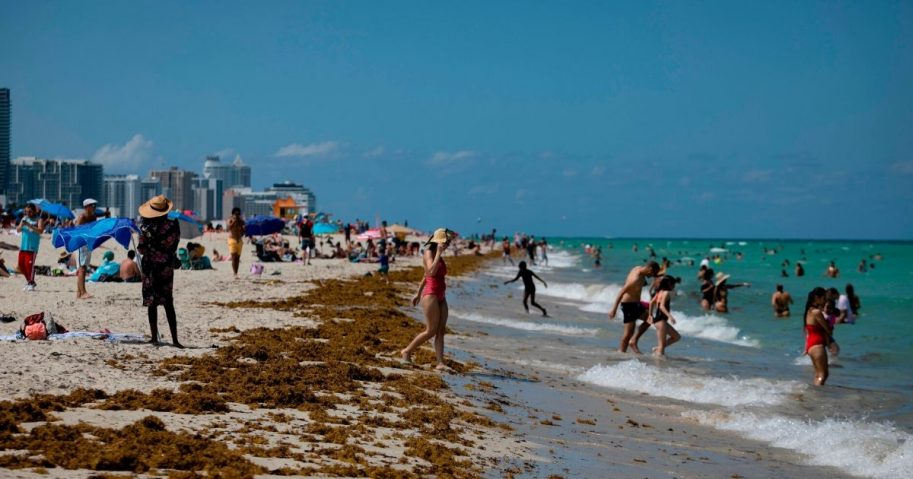 People gather on the beach in Miami Beach, Florida, on June 16, 2020.
