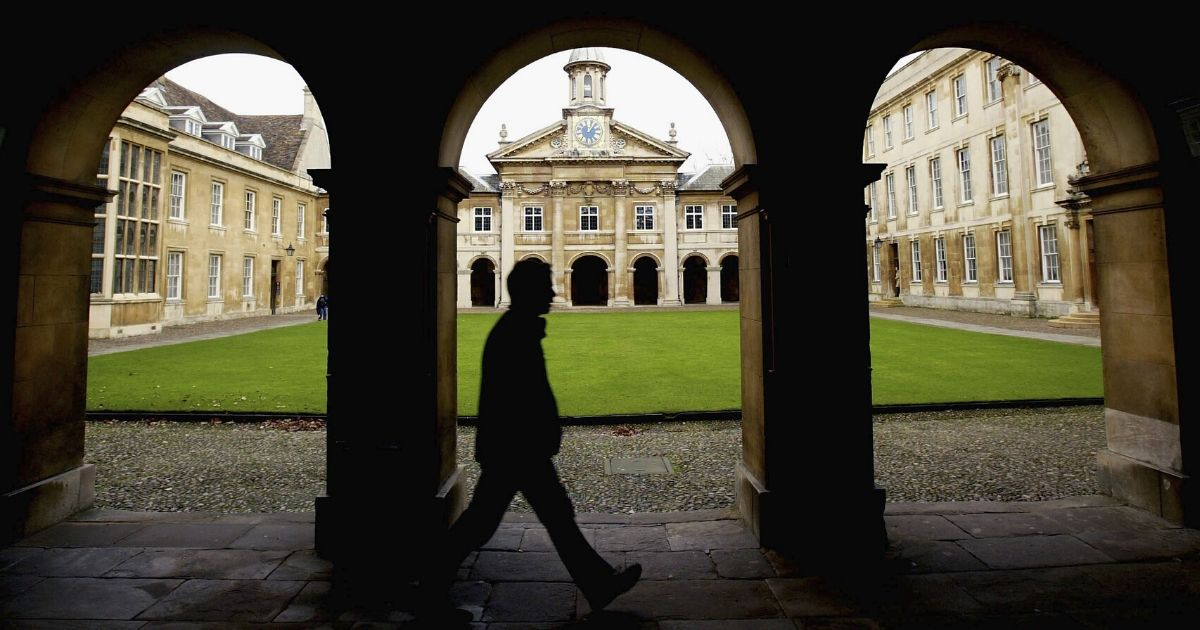 A student walks on the campus of Cambridge University in Cambridge, England.