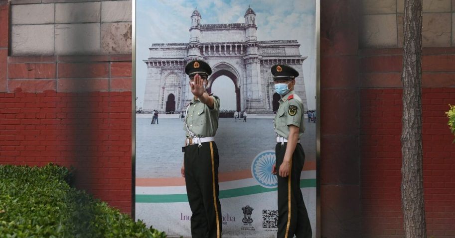 Two Chinese paramilitary police officers patrol outside the Indian embassy in Beijing on June 16, 2020. China on June 16 accused India of crossing a disputed border between the two countries, as the Indian army said three of its soldiers had been killed in violent clashes.
