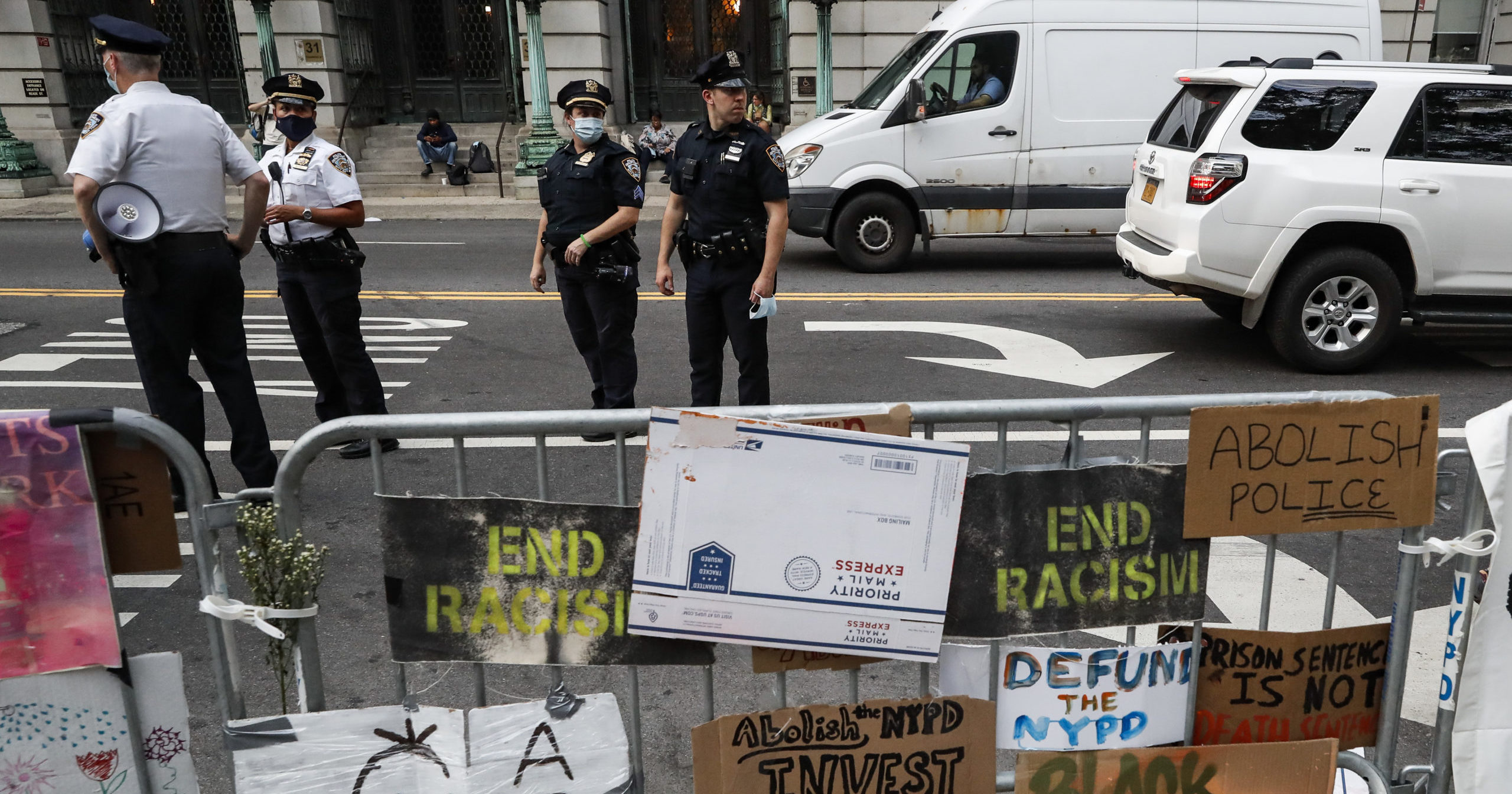 Police stand on the street beside a protest encampment outside City Hall on June 26, 2020, in New York City.