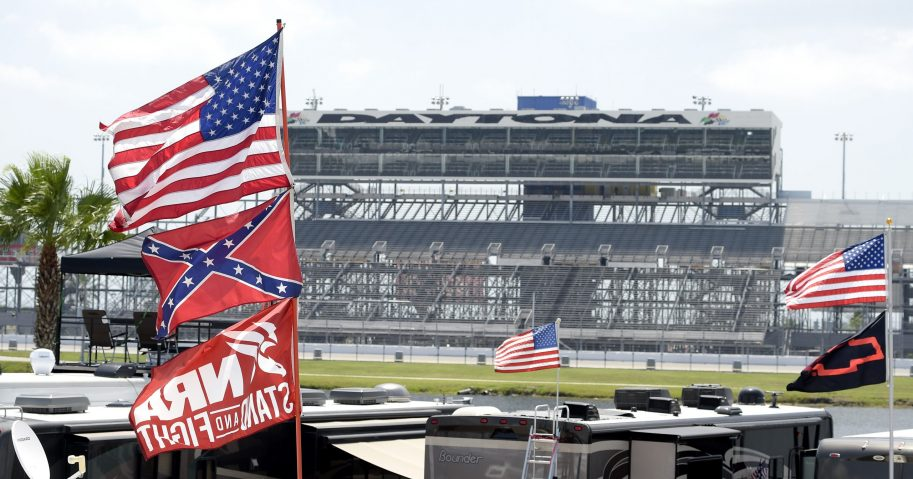 In this July 4, 2015, file photo, Confederate and American flags fly on top of motor homes at Daytona International Speedway in Daytona Beach, Florida.