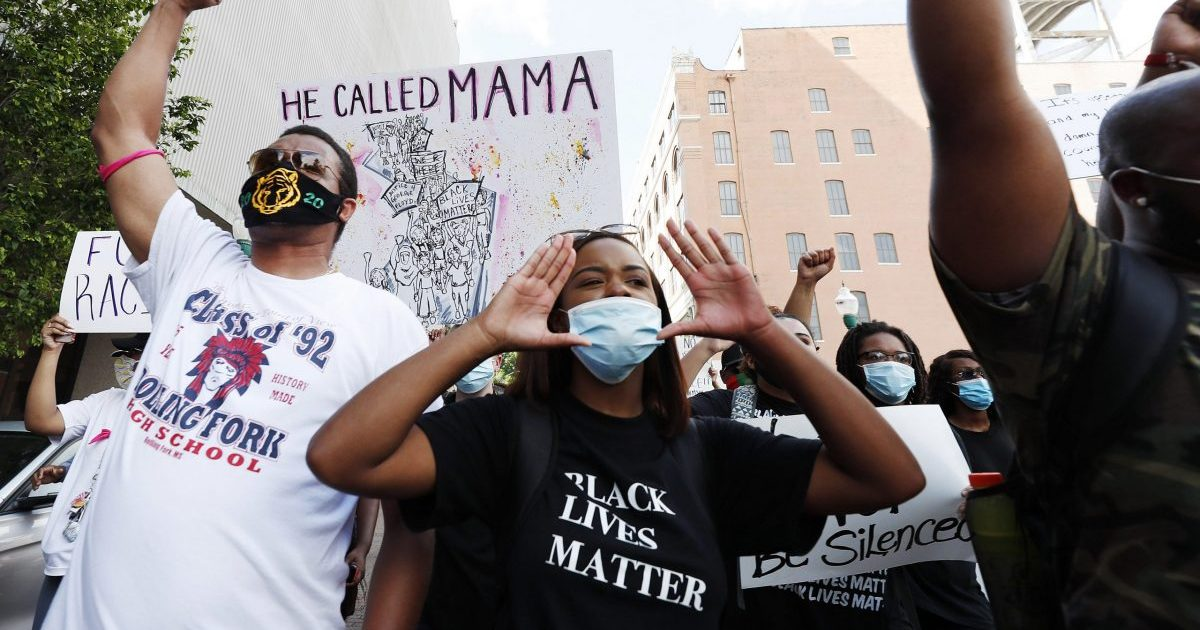 Maisie Brown, a member of the Mississippi branch of Black Lives Matter, leads a protest march