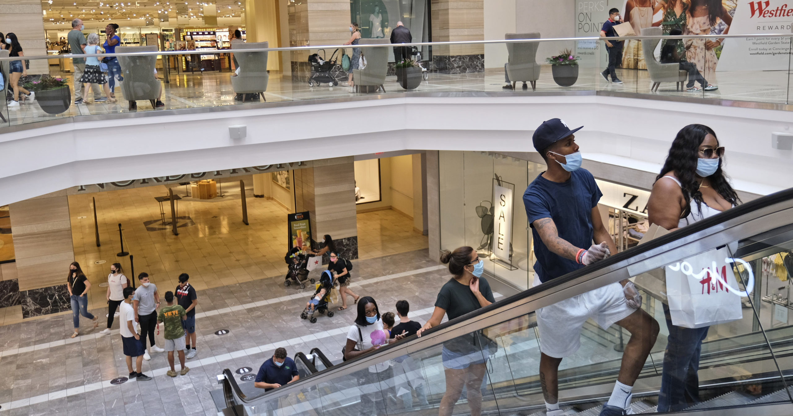 In this June 29, 2020, file photo, shoppers move about in Garden State Plaza in Paramus, New Jersey. U.S. consumer confidence rose to 98.1 in June, reflecting the partial re-opening of the country.