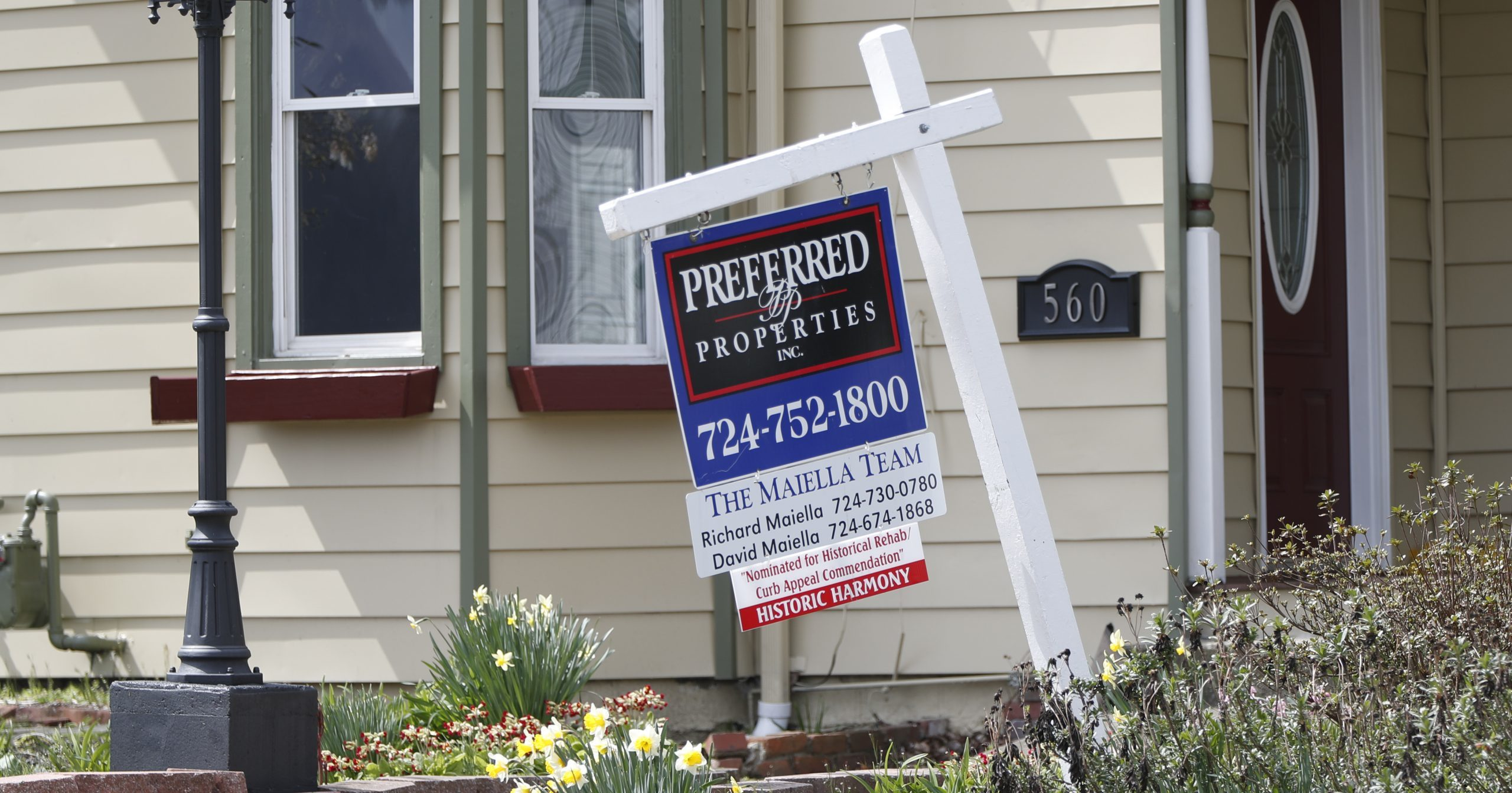 This April 16, 2020, photo shows a real estate company sign that marks a home for sale in Harmony, Pennsylvania.