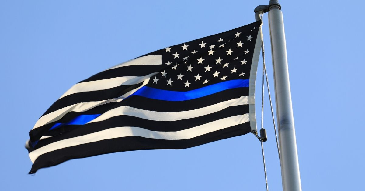 The blue line flag is seen flying in this stock image.