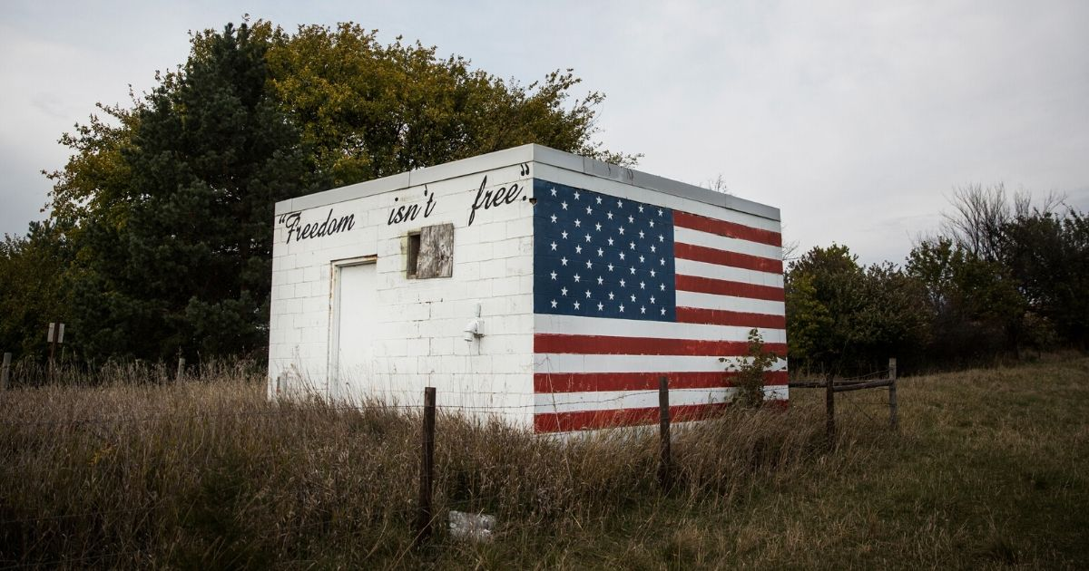"""A brick building with the words """"Freedom isn't free"""" is seen on Oct. 12, 2014, outside Neligh, Nebraska."""