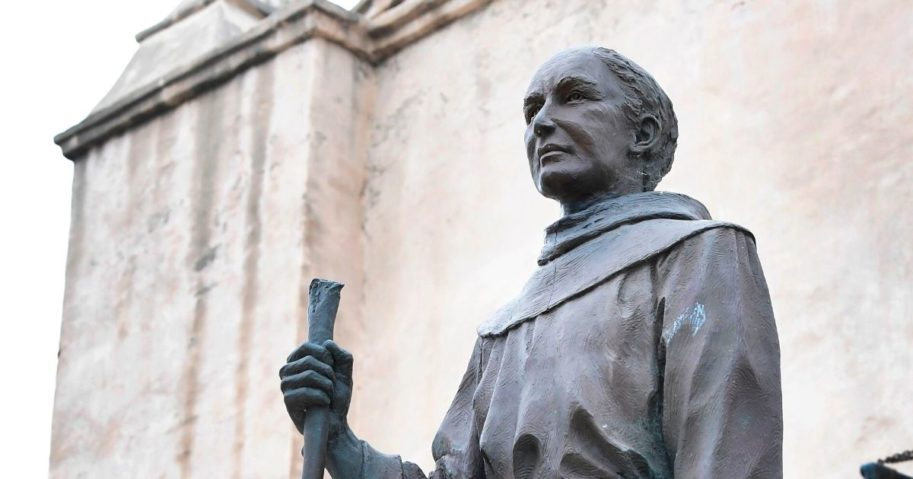 A statue of St. Junipero Serra is seen in front of the San Gabriel Mission in San Gabriel, California, on June 21, 2020.