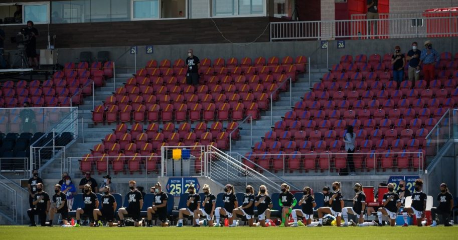 Members of Portland Thorns FC kneel during the national anthem before a game against the North Carolina Courage during the first round of the NWSL Challenge Cup at Zions Bank Stadium on June 27, 2020, in Herriman, Utah.