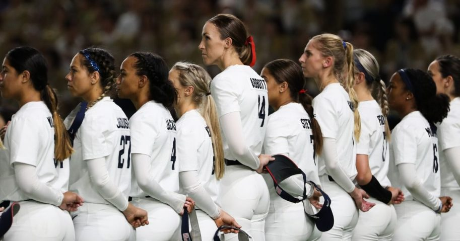 Players stand during the national anthem prior to a softball game between Japan and the United States at the Tokyo Dome on June 25, 2019, in Tokyo, Japan.