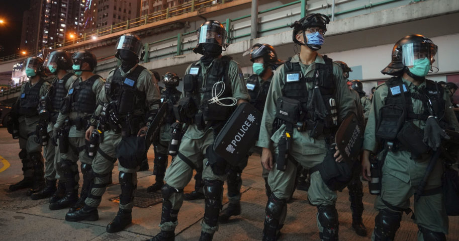 Riot police stand guard at a protest against the new security law during the anniversary of the Hong Kong handover from Britain on July 1, 2020, in Hong Kong. Hong Kong police have made their first arrests under a new national security law imposed by mainland China. The law, which took effect Tuesday night, makes activities deemed subversive or secessionist punishable by up to life in prison.
