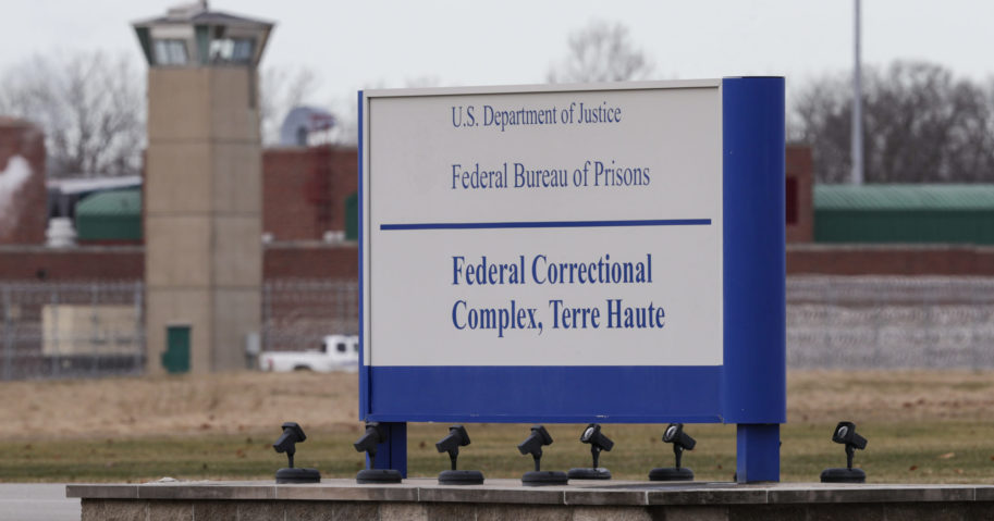 In this Dec. 10, 2019, file photo, the guard tower flanks the sign at the entrance to the U.S. Penitentiary in Terre Haute, Indiana.