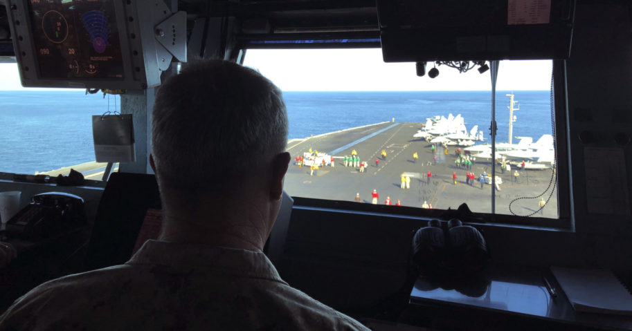 In this Feb. 1, 2020, file photo, Marine Gen. Frank McKenzie, top U.S. commander for the Middle East, watches flight operations on board the USS Harry S. Truman in the North Arabian Sea.