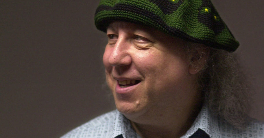 This file photo dated April 7, 2001, shows British rock and blues guitarist Peter Green, a founding member of Fleetwood Mac, backstage before performing with Peter Green's Splinter Group at B.B. King Blues Club & Grill in New York. Lawyers representing the family of Peter Green said in a statement on July 25, 2020, that he has died, aged 73.