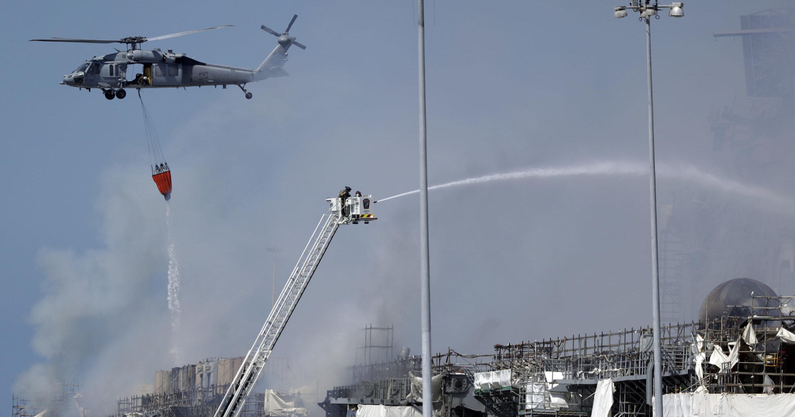 Fire crews battle the fire on the USS Bonhomme Richard on July 13, 2020, in San Diego.