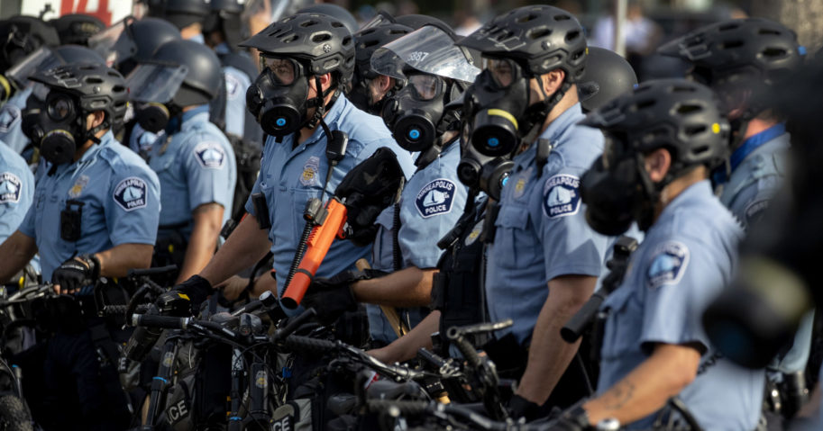In this May 27, 2020, file photo, police gather as protests continue at the Minneapolis 3rd Police Precinct in Minneapolis. More than 150 Minneapolis police officers have started the process of filing for disability claims since the death of George Floyd and the ensuing unrest in the city, with the majority citing post-traumatic stress disorder as the reason for their planned departure, according to an attorney representing the officers.