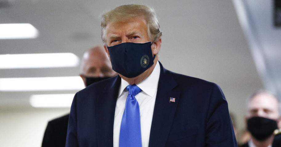 President Donald Trump wears a mask as he walks down the hallway during his visit to Walter Reed National Military Medical Center in Bethesda, Maryland, on July 11, 2020.