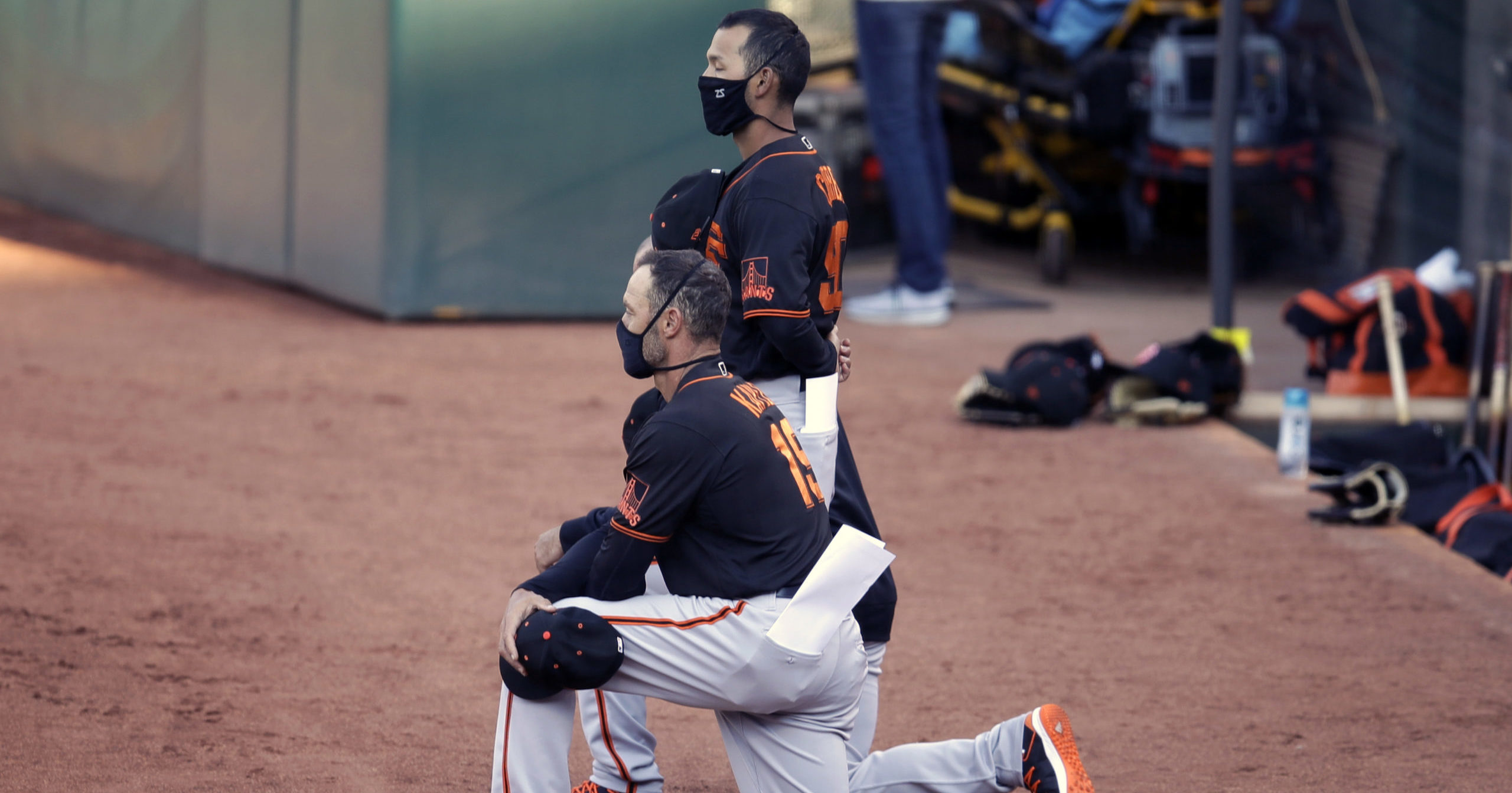 San Francisco Giants manager Gabe Kapler kneels during the national anthem prior to an exhibition baseball game against the Oakland Athletics on July 20, 2020, in Oakland, California.