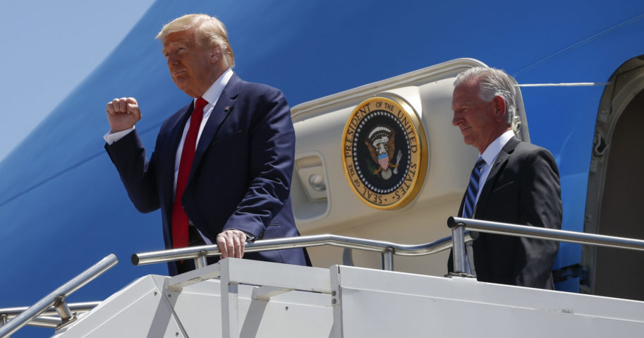 In this June 11, 2020, file photo, President Donald Trump gestures as he steps off Air Force One at Dallas Love Field in Dallas with Senate candidate Tommy Tuberville. Trump has endorsed Tuberville in the race against his former attorney general.