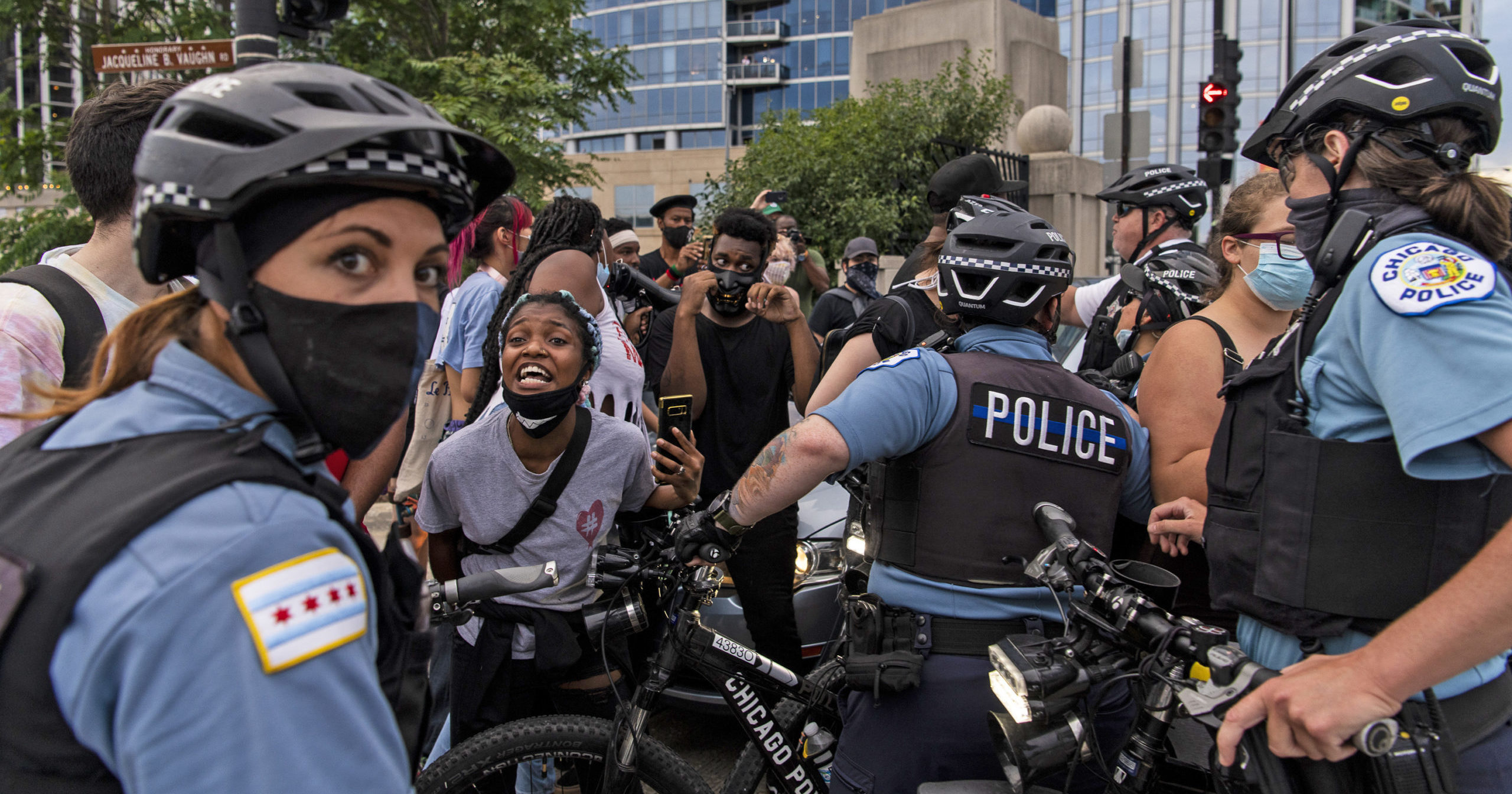 Chicago police and protesters crowd around a vehicle on July 20, 2020, in Chicago.