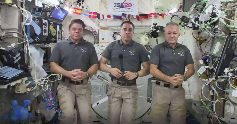 This photo provided by NASA shows, from left, astronauts Bob Behnken, Chris Cassidy and Doug Hurley during an interview on the International Space Station on July 31, 2020. Behnken and Hurley are scheduled to leave the International Space Station in a SpaceX capsule on Aug. 1 and splashdown off the coast of Florida on Aug. 2.