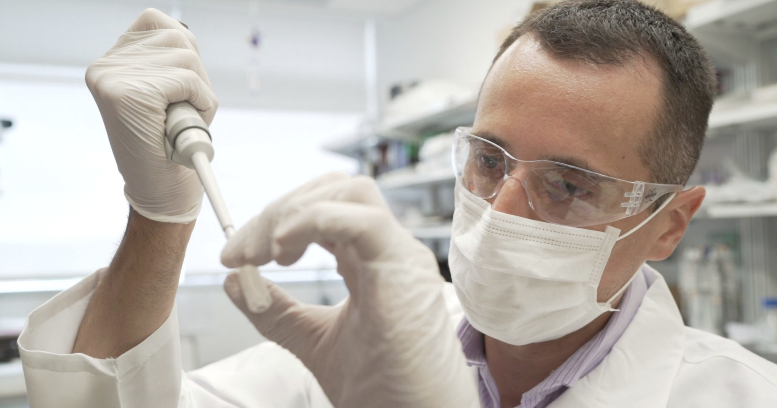 In this image from video provided by Washington University, researcher Nicolas Barthelemy works on a p-tau217 test for Alzheimer's disease at a laboratory in St. Louis, Missouri, on July 27, 2020. Several companies and universities have developed versions of these tests, which look for a form of tau protein, one of the substances that can build up and damage the brains of people with Alzheimer's.