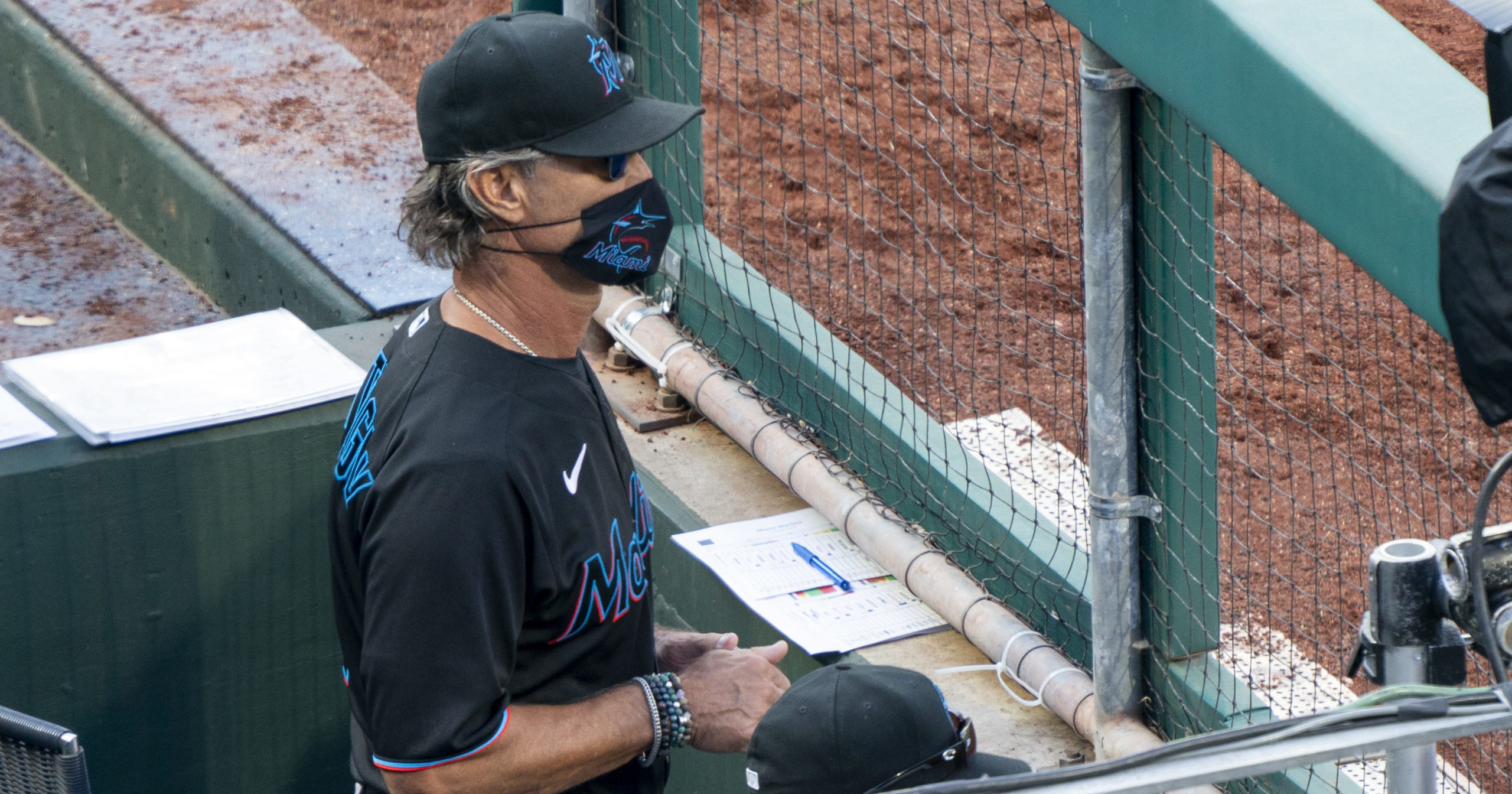 Miami Marlins manager Don Mattingly looks out from the dugout during the eighth inning of a game against the Philadelphia Phillies at Citizens Bank Park on July 25, 2020.