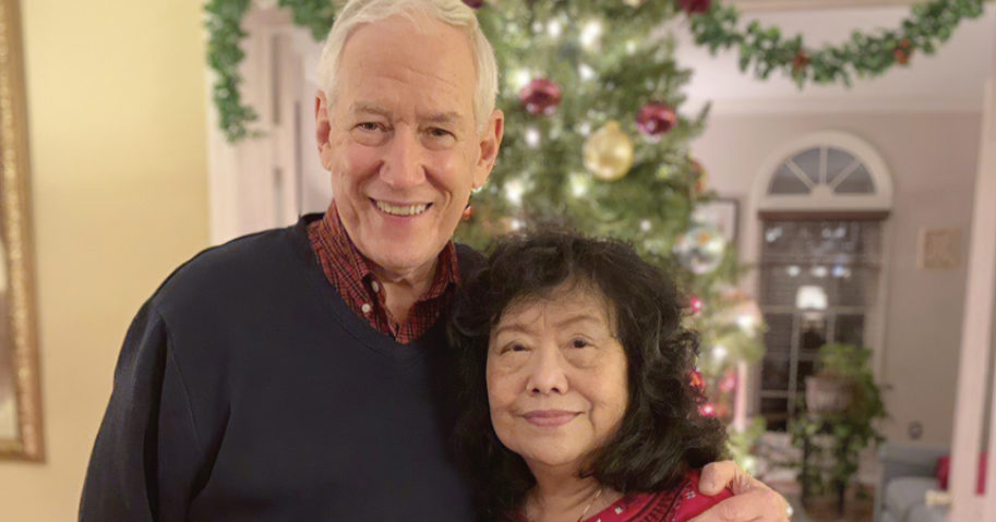In this December, 2018, photo released by the Stemberger family, Victor and his wife Han Stemberger are shown at their home in Centreville, Virginia.