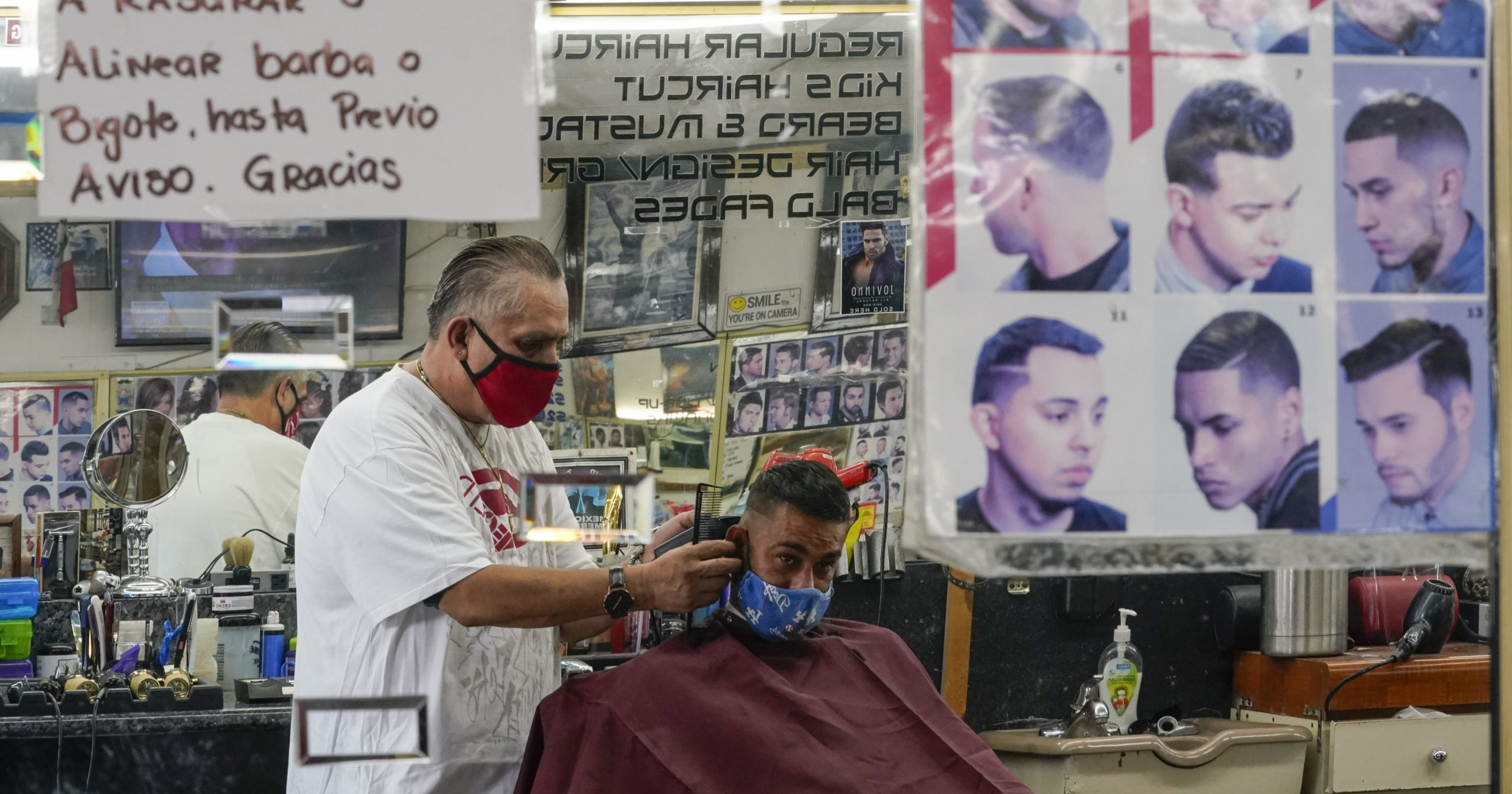 Edgar Gomez has his hair cut by George Garcia, owner of George's Barber Shop on July 14, 2020, in San Pedro, California. Gov. Gavin Newsom this week ordered that indoor businesses including salons and barber shops close due to the spread of COVID-19.