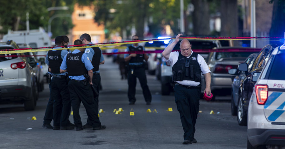 Chicago police officers investigate the scene of a deadly shooting July 5, 2020, in which a 7-year-old girl and a man were fatally shot during a Fourth of July party.