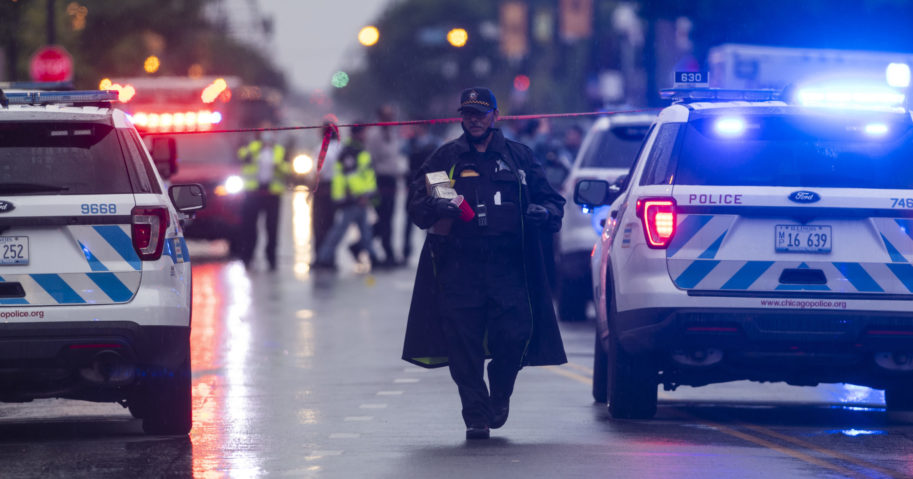 Chicago police investigate the scene of a shooting where more then a dozen people were shot in the Gresham neighborhood of Chicago on July 21, 2020.