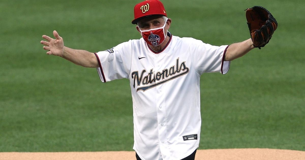 Dr. Anthony Fauci, director of the National Institute of Allergy and Infectious Diseases, reacts after throwing out the ceremonial first pitch prior to the game between the New York Yankees and the Washington Nationals at Nationals Park on July 23, 2020, in Washington, D.C.