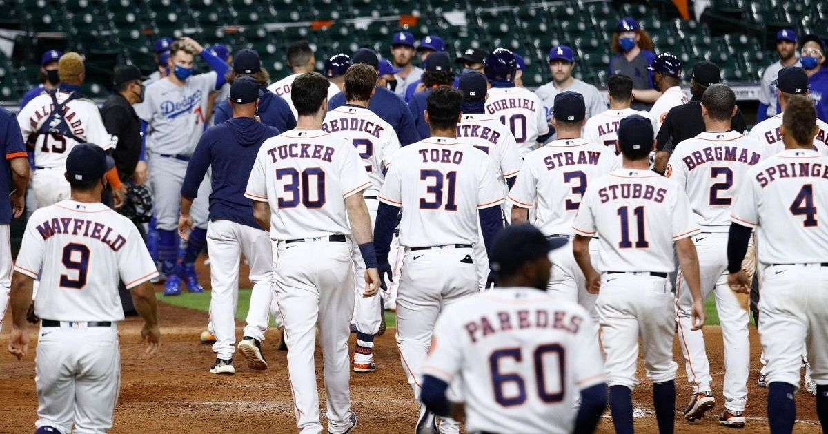 Both teams' benches empty after Joe Kelly of the Los Angeles Dodgers threw several high inside pitches to the Houston Astros' Alex Bregman and Carlos Correa in a game at Minute Maid Park on July 28, 2020.