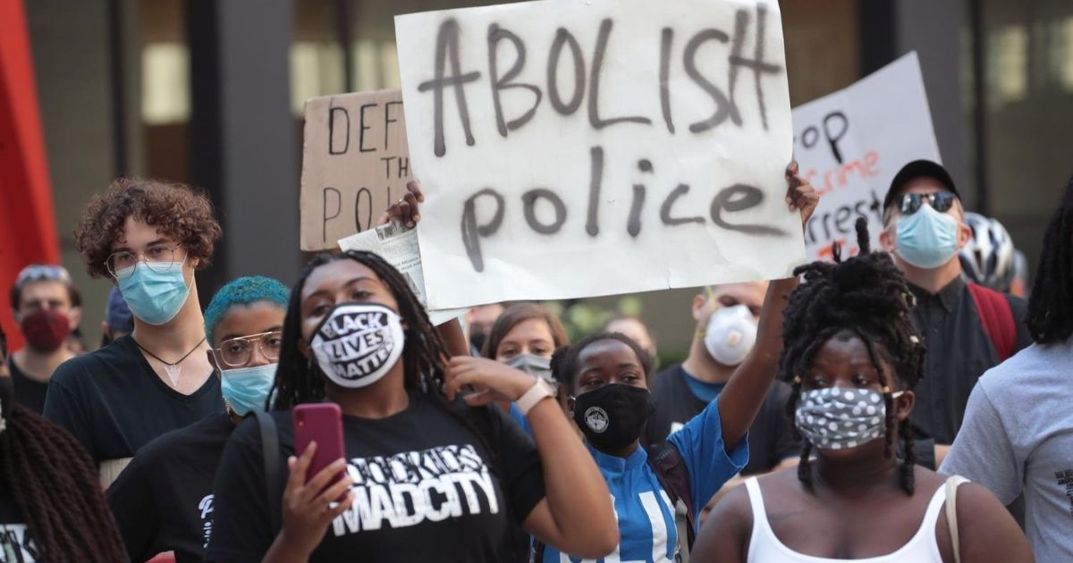 Activists hold a rally in the federal building plaza in Chicago
