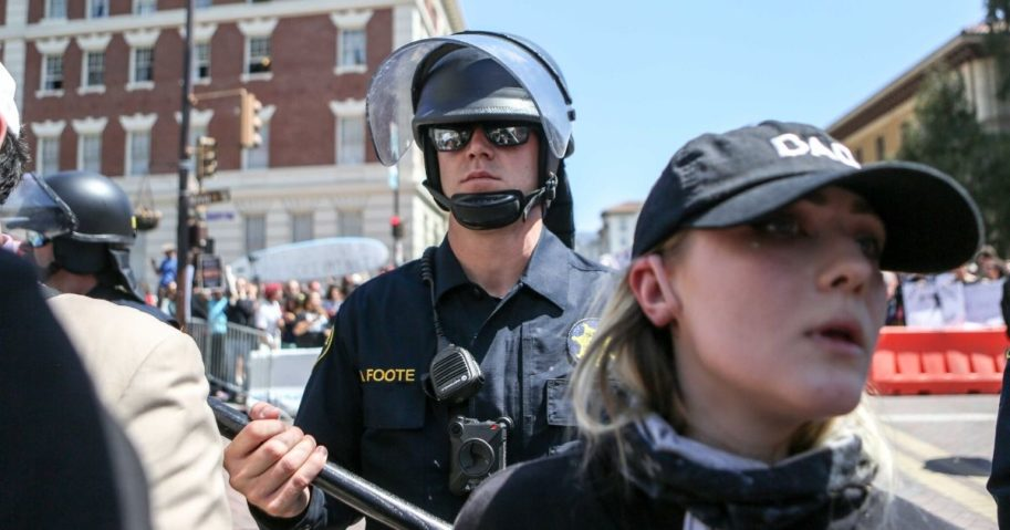 Riot police stand guard during a No To Marxism rally on Aug. 27, 2017, at Martin Luther King Jr. Park in Berkeley, California.