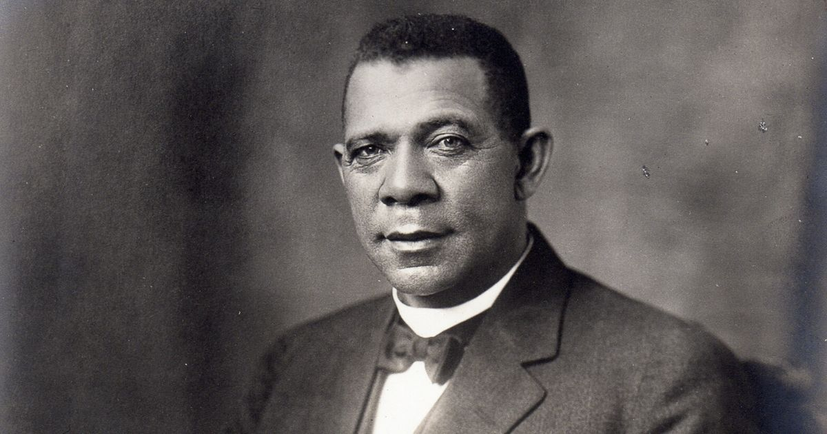 An early twentieth century seated studio portrait of American educator, economist and industrialist Booker T. Washington (1856-1915), founder of the Tuskegee Institute in Alabama, is seen above.