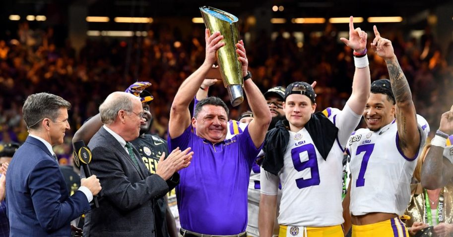 LSU head coach Ed Orgeron raises the National Championship Trophy after the Tigers beat Clemson 42-25 at the Mercedes-Benz Superdome in New Orleans on Jan. 13, 2020.