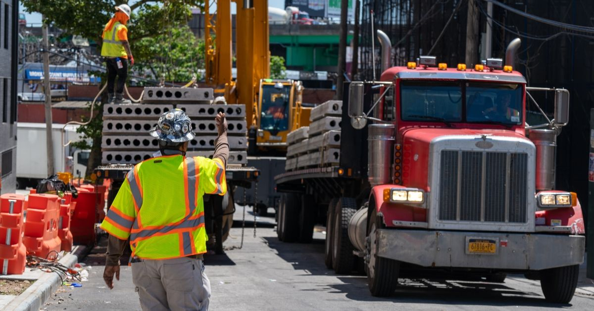 Construction workers are on the job in the Bronx borough of New York City on June 8, 2020.