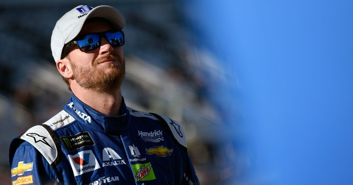 Dale Earnhardt Jr., driver of the #88 Nationwide Chevrolet, stands on the grid during qualifying for the Monster Energy NASCAR Cup Series 59th Annual DAYTONA 500 at Daytona International Speedway on Feb. 19, 2017, in Daytona Beach, Florida.