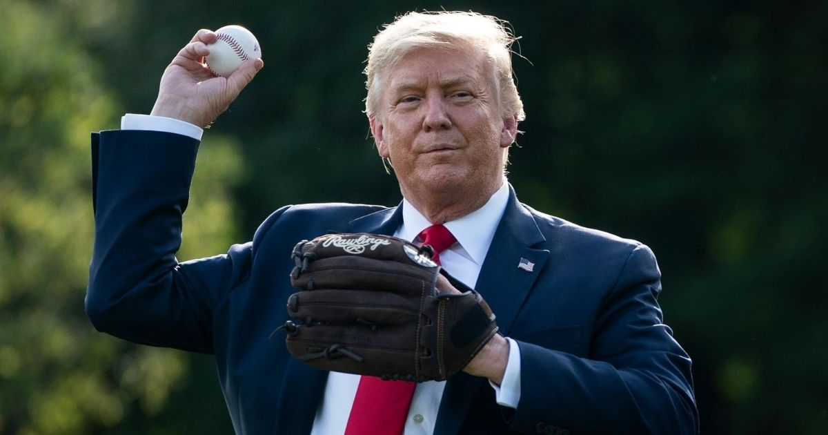 President Donald Trump throws a baseball on the South Lawn of the White House on July 23, 2020, in Washington, D.C.