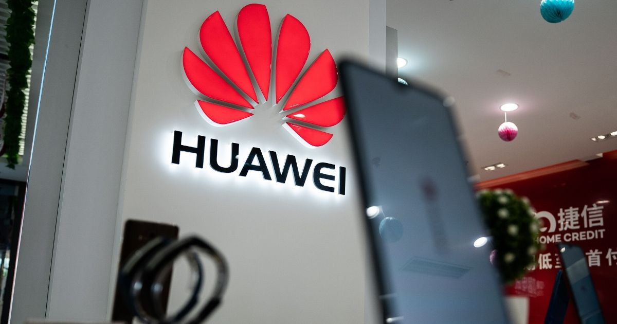 A Huawei logo is displayed at a retail store in Beijing on May 20, 2019.