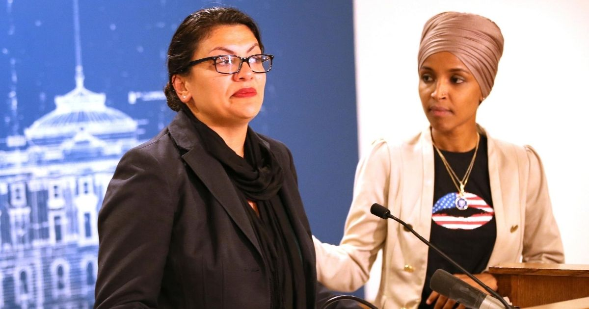 Democratic Minnesota Rep. Ilhan Omar, right, consoles Democratic Michigan Rep. Rashida Tlaib during a news conference on Aug. 19, 2019, at the State Capitol in St. Paul, Minnesota.