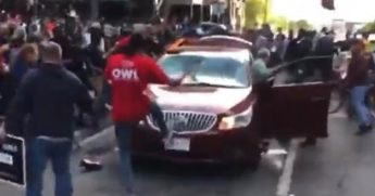 Leftists attacking car.