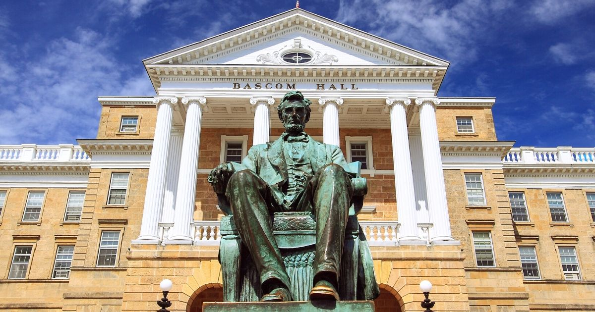 A statue of Abraham Lincoln sits in front of Bascom Hall at the University of Wisconsin, Madison.