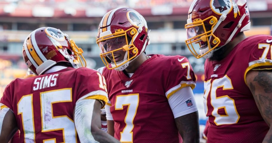Dwayne Haskins (No. 7) of the Washington Redskins celebrates with Steven Sims (No. 15) after throwing a touchdown pass during the first half of a game against the New York Giants at FedExField in Landover, Maryland, on Dec. 22, 2019.