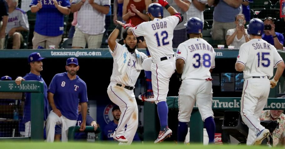 Rougned Odor of the Texas Rangers celebrates with Elvis Andrus after hitting a three-run home run against the Tampa Bay Rays at Globe Life Park in Arlington on Sept. 11, 2019.