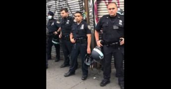 Police officers in New York City listen to a man verbally abuse them.